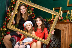 Smiling family celebrate x-mas  in santa helper hats Royalty Free Stock Photography
