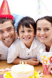 Smiling family celebrating son's birthday Royalty Free Stock Photography