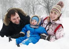Smiling family with child in winter Stock Image