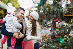Smiling family in Christmas fair Royalty Free Stock Image