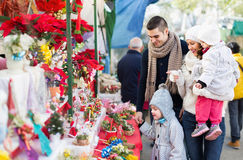 Smiling family in Christmas fair Stock Photography
