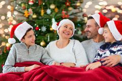 Smiling family at Christmas. Time holding lots of presents at home Stock Photo