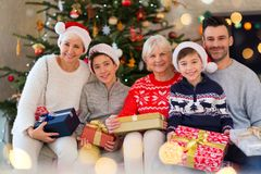 Family with Christmas presents. Smiling family at Christmas time holding lots of presents at home Royalty Free Stock Images