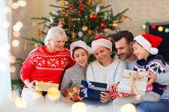 Family with Christmas presents. Smiling family at Christmas time holding lots of presents at home Royalty Free Stock Photos