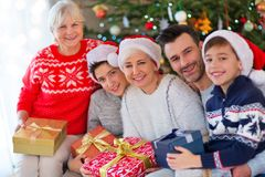 Family with Christmas presents. Smiling family at Christmas time holding lots of presents at home Stock Photography