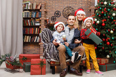 Smiling family in Christmas tree Stock Photography