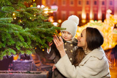 Smiling family close to green Christmas tree royalty free stock photo