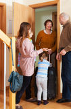 Smiling family coming to grandmother. Happy family coming to grandmother home Royalty Free Stock Photography