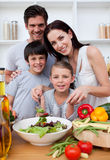 Smiling family cooking together Royalty Free Stock Photos