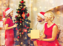 Smiling family decorating christmas tree Royalty Free Stock Photography