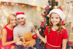 Smiling family decorating christmas tree Stock Image