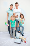 Smiling family decorating their house Stock Images