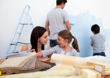 Smiling family decorating their new home Royalty Free Stock Images