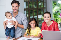Smiling family at desk Royalty Free Stock Photo