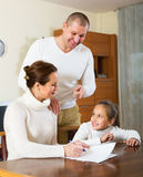 Smiling family with documents Stock Photography