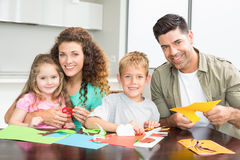Smiling family doing arts and crafts together at the table Stock Photo