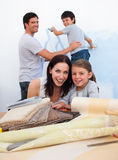 Smiling family doing up their new home Stock Photography