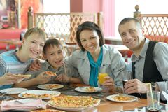 Smiling family eating pizza Stock Photography