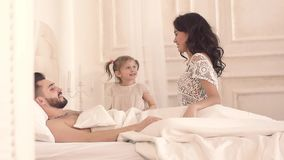 Smiling family enjoying waking up on such a sunny morning stock footage