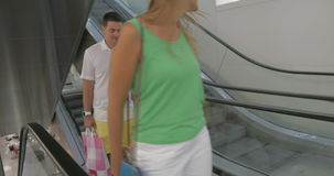 Smiling Family on the Escalator after Shopping stock footage