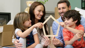 A smiling family of four settling in a new place stock footage