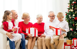 Smiling family with gifts at home Royalty Free Stock Photos
