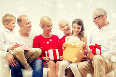 Smiling family with gifts at home Stock Images