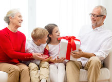 Smiling family with gifts at home Stock Photos