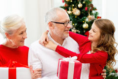 Smiling family with gifts at home Royalty Free Stock Photography