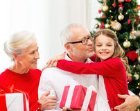 Smiling family with gifts at home Royalty Free Stock Images
