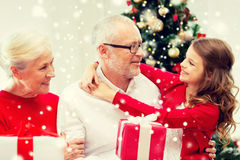 Smiling family with gifts at home Stock Photo