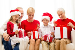 Smiling family with gifts at home Royalty Free Stock Image