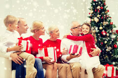 Smiling family with gifts hugging at home Royalty Free Stock Image