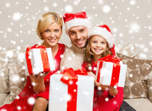 Smiling family giving many gift boxes Royalty Free Stock Image