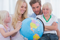 Smiling family with globe Stock Image