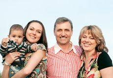 Smiling family and grandparents in the countryside Stock Image