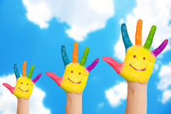 Smiling family hands on a sky background. Royalty Free Stock Photos