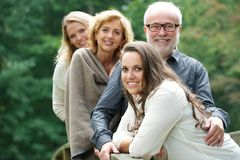 Smiling family happy together outdoors Royalty Free Stock Photo