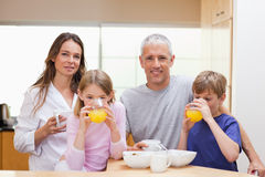 Smiling family having breakfast Royalty Free Stock Image