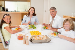 Smiling family having dinner Stock Image