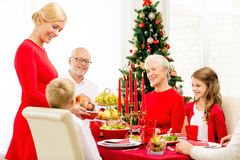 Smiling family having holiday dinner at home Stock Images