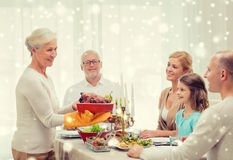 Smiling family having holiday dinner at home Royalty Free Stock Photography