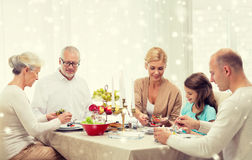 Smiling family having holiday dinner at home Stock Image