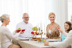 Smiling family having holiday dinner at home Royalty Free Stock Photos