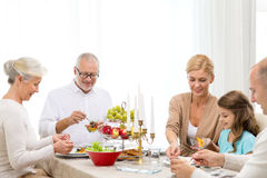 Smiling family having holiday dinner at home Stock Photography