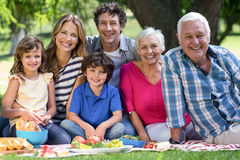 Smiling family having a picnic. In the garden stock images
