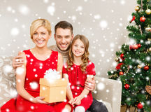 Smiling family holding gift box Royalty Free Stock Photography