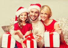 Smiling family holding gift boxes and sparkles Stock Photo