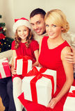 Smiling family holding many gift boxes Stock Photo
