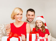 Smiling family holding many gift boxes Royalty Free Stock Photo